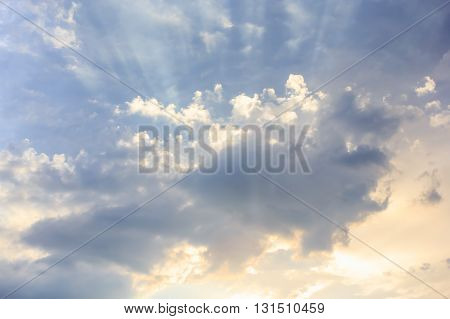 Beautiful landscape with the sun in the clouds. Blue sky background.
