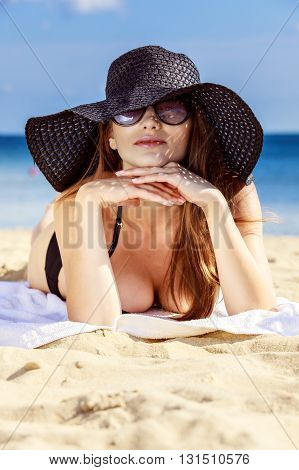 Beautiful Sexy Girl In Swimwear Laying On Sandy Beach. Sea Coast