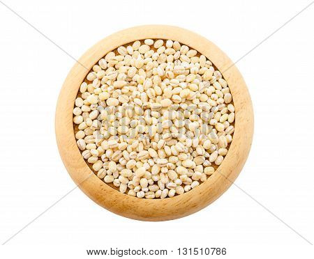 Pile of Pearl Barley on wooden dish isolated on white background saved clipping path.