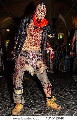 Bologna, Italy - May 21, 2016: Bologna zombie apocalypse walk. A frightening and terrifying zombies walking down the street at night.