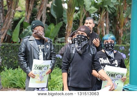 ANAHEIM CALIFORNIA, May 25, 2016: Protesters wear masks as they yell argue with supporters  and cause trouble for the police at the Republican Presidential Candidate Donald J. Trump rally 5.25.2016