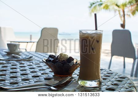 Iced coffee on a table at the beach