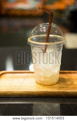 empty plastic cup on table in coffee shop