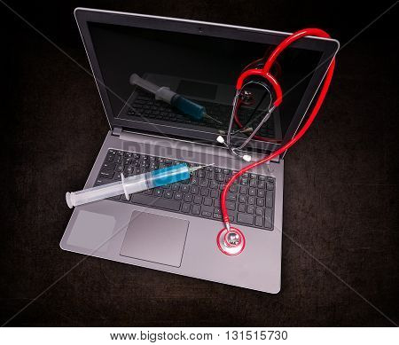 Laptop computer and stethoscope, service and repair concept