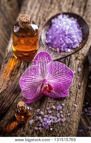 Lavender bath salt and massage oil on wooden background