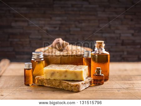Homemade soap with organic essential oil on wooden background