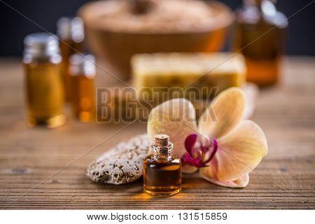 Health spa with massage oil, studio shot