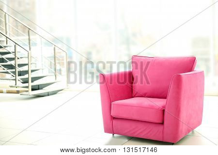 Comfortable pink chair indoors