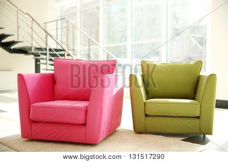 Two comfortable armchairs indoors