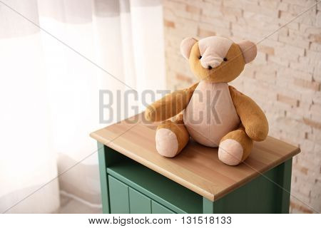Kid's toy on a bedside table