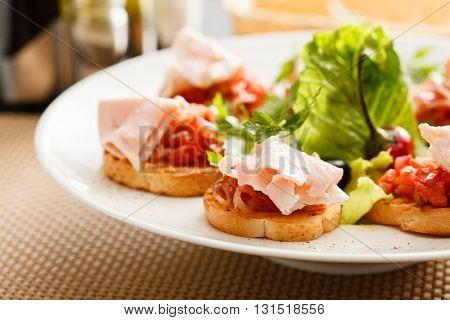 Bruschetta with tomato and ham