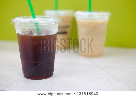 iced americano with ice coffee background on table