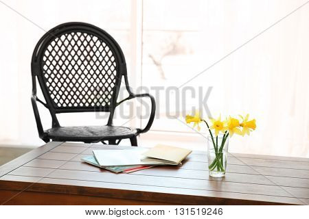 Modern living room interior. Chair beside a wooden table.