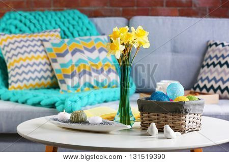 Design interior of living room with fresh narcissus flowers