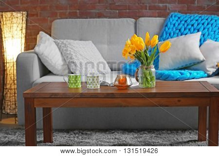 Beautiful interior with yellow flowers of living room