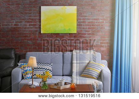 Beautiful interior with yellow narcissus of living room
