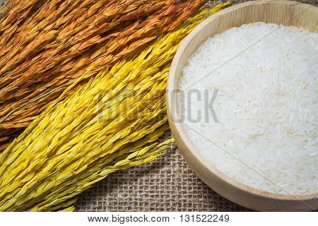 Rice In Wooden Bowl On Sack Or Wood Table Background