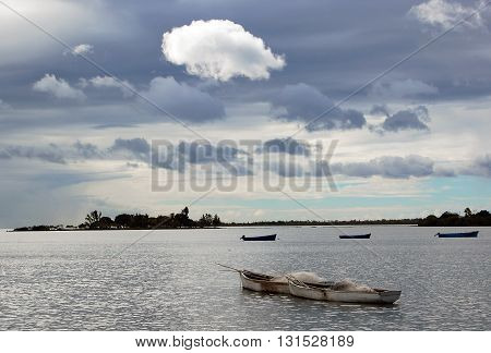 Fishermen boat on beautiful cloudy sky background