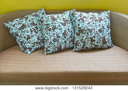 Beautiful luxury pillow on rattan sofa in living room