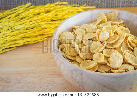 Cornflakes And Yellow Rice With Sack Or Tablecloth Background