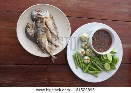 fried mackerel with vegetable and chili sauce (Thai food)