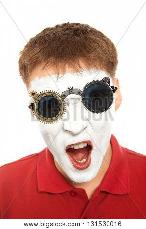 Close-up portrait of a male evil mime with mechanical steampunk glasses. Isolated over white