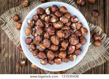 Hazelnuts On Vintage Wooden Background (selective Focus)