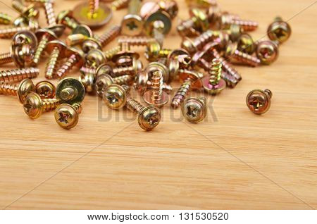 Screw On Wooden Background
