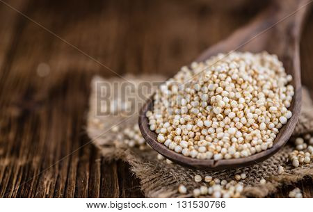 Portion Of Puffed Quinoa (selective Focus) On An Old Wooden Table