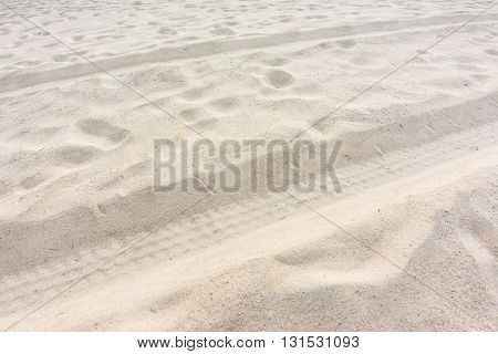 Tire from tracks on the sand abstract background