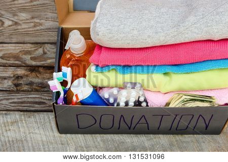 Donation box with clothes, medication, living essentials and money