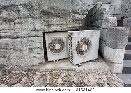 Group Of Air Compressor In The Stone Wall