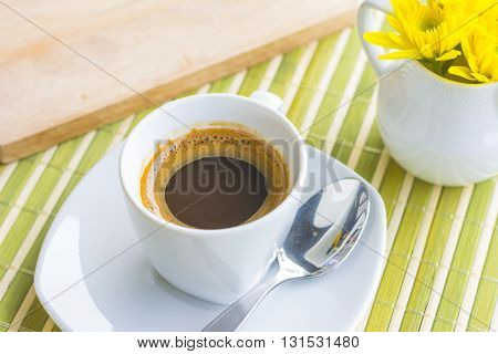 A Cup Of Coffee Or Hot Coffee On Wooden Table , Soft-tone , Focus At Bubble Of Coffee