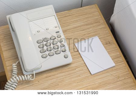 The Phone On The Table With A Paper Notebook And Pencil. In The Room Or Bedroom.