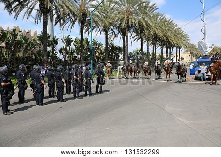 ANAHEIM CALIFORNIA, May 25, 2016: Police in riot gear and on horse back protect both supporters and protesters from each other during the Republican Nominee Donald J. Trump Rally Anaheim 5.25.2016
