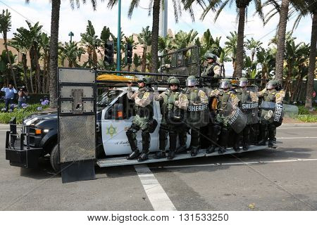 ANAHEIM CALIFORNIA, May 25, 2016: Police in riot gear arrive protect both supporters and protesters from each other during the Republican Nominee Donald J. Trump Rally Anaheim 5.25.2016