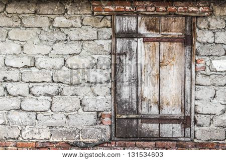 Old wooden door in rural barn closeup