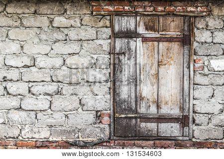 Old wooden door in rural barn closeup
