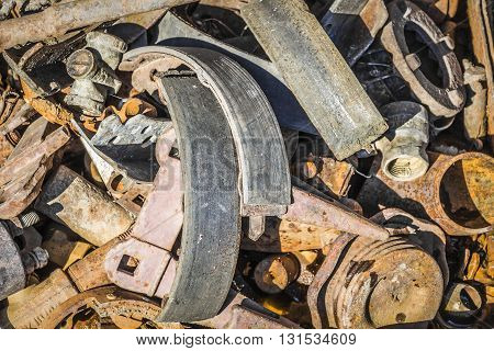 Old rusty parts and tools for repair of machinery