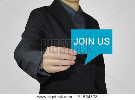 Businessman holding card with Join us about invitation concept.