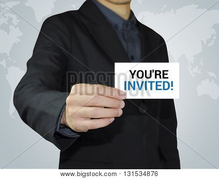 Businessman holding card with you're invited about invitation concept.