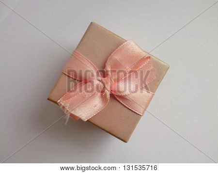 Little gift box with pink silky bow. Top view