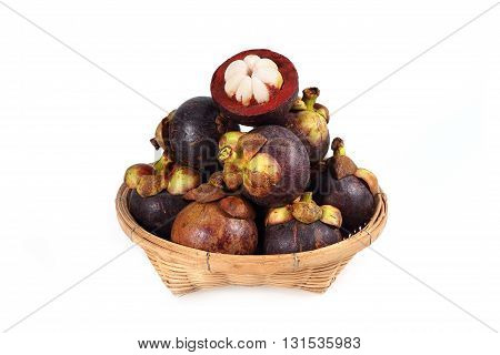 Mangosteen in basket isolate on white background