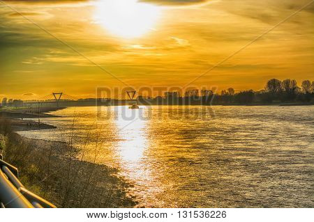 Artistic work of my own. HDR processing. Romantic sunset over the Rhein.