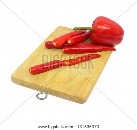 Red chilli wooden chopping board on white background.