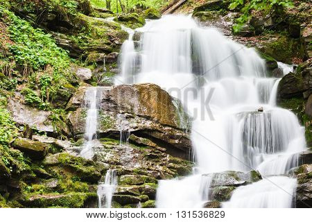Small Waterfall Of Mountain River