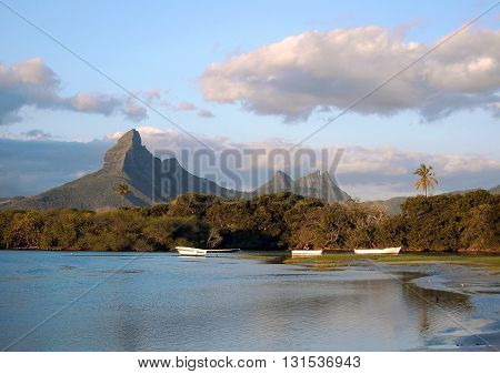 Volcanic mountain peaks at sunset on Tamarin beach Mauritius