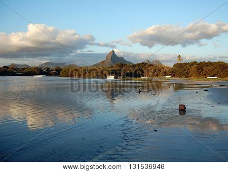 Tamarin bay landscape at sunset with mountain in background