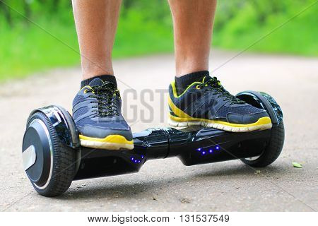 riding a hoverboard - electrical scooter, smart balance wheel, gyro scooter, personal portable eco transport