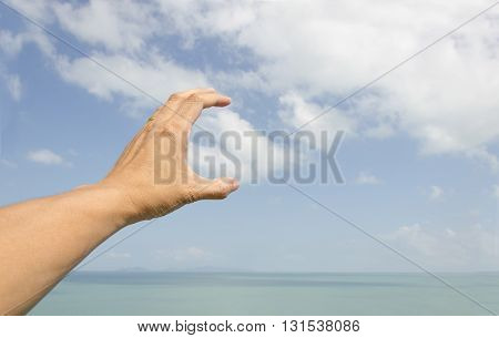 left hand of the man over the  calm sea
